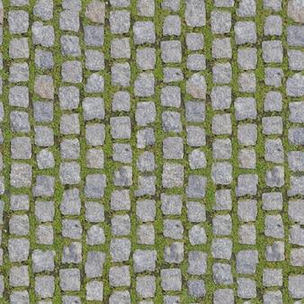 草と石のブロック。シームレスな背景。