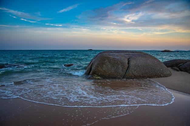 Stone in blue baltic sea.