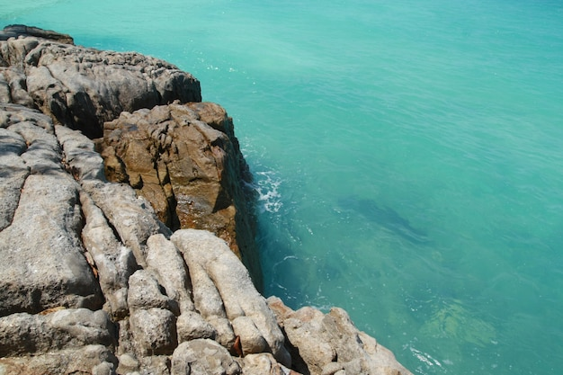 Stone and blue sea