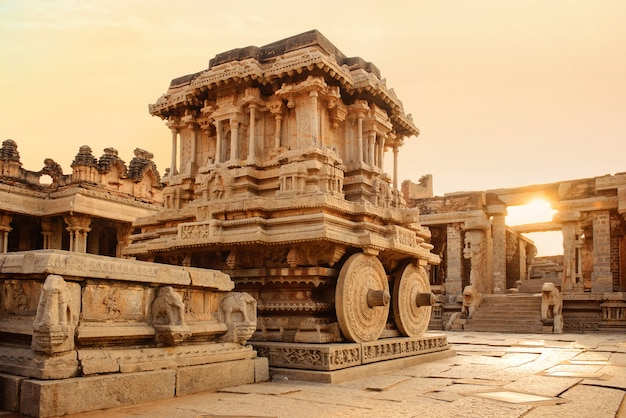 Stone chariot in hampi vittala temple at sunset