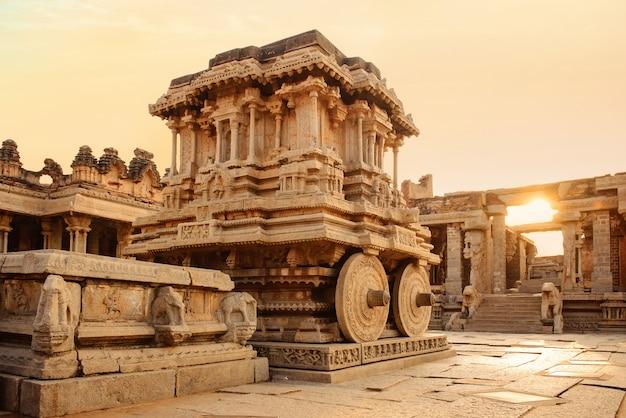Stone chariot in hampi vittala temple at sunset