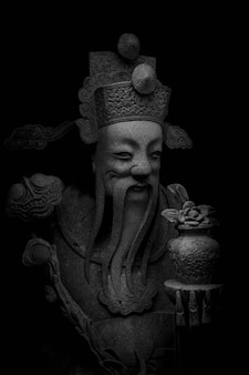 Stone chinese nobility statue in thailand temple
