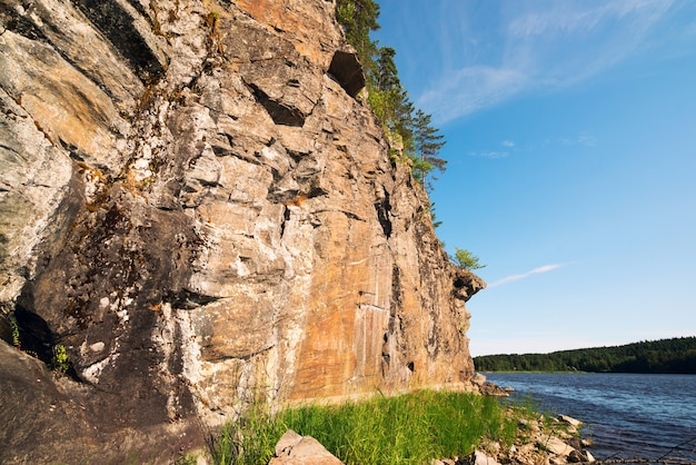 Stone cliff on the shore of lake