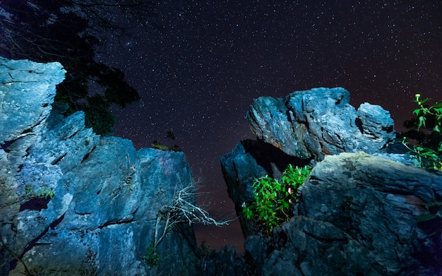 Stone cliff with star sky view