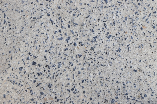 Stone in concrete closeup texture and cement abstract road fall background