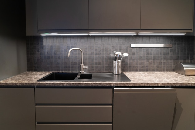 Stone counter top on kitchen room in dark colors