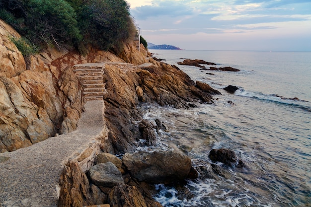 Stone ecological trail along the rocky coast of mediterranean sea in france