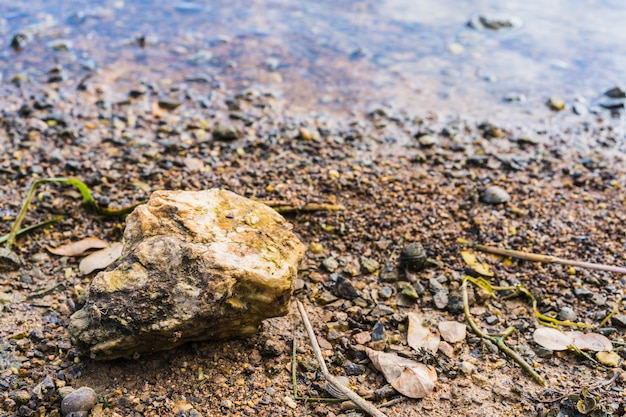Stone on gravel background with focus at the top. seashore.