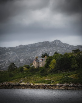 Stone house by the lake on a cloudy day