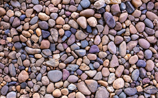 Stone path background above. close the wallpaper. a lot of stones. the stones are small and large. different sizes and colors of stones. gravel.