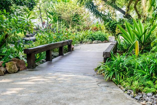 Stone pathway and wooden bridge into garden