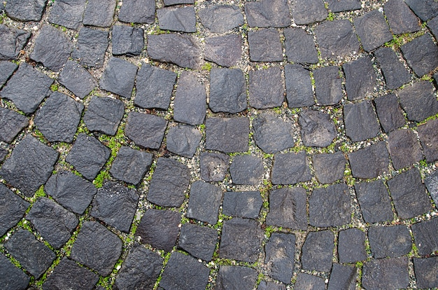 Stone pavement texture. granite cobblestoned background. abstract of old cobblestone close-up. seamless . prague