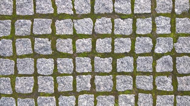 정사각형 형태의 돌 포장 돌. 디자인에 대 한 배경입니다. 고품질 사진