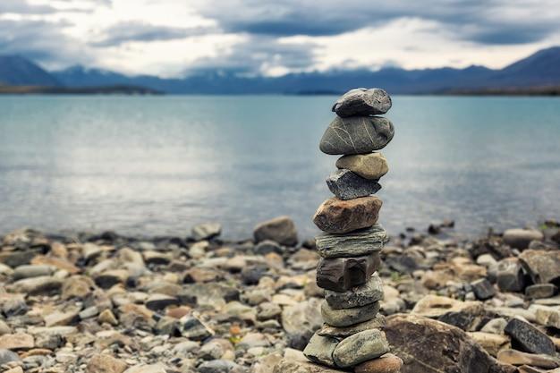 Stone pyramid on the shore of lake tekapo, south island, new zealand
