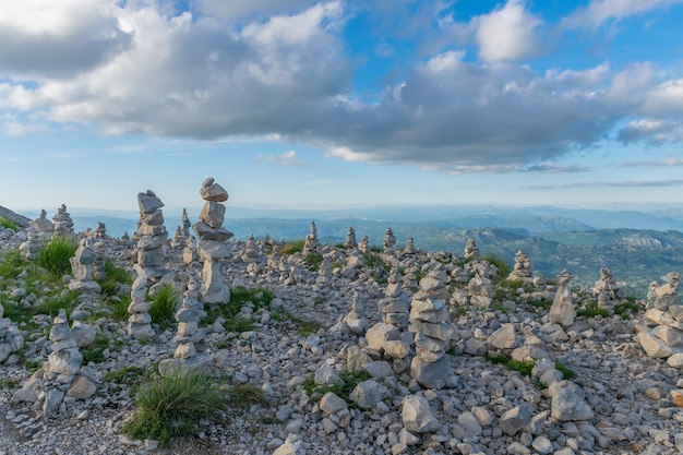 Stone pyramids were left by tourists while traveling through high mountains.