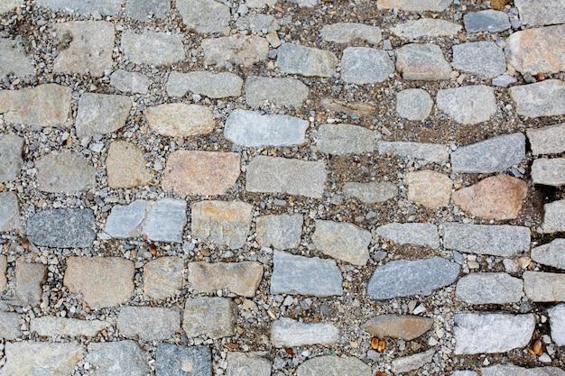 砂利と石の道路のテクスチャ。クローズアップショット