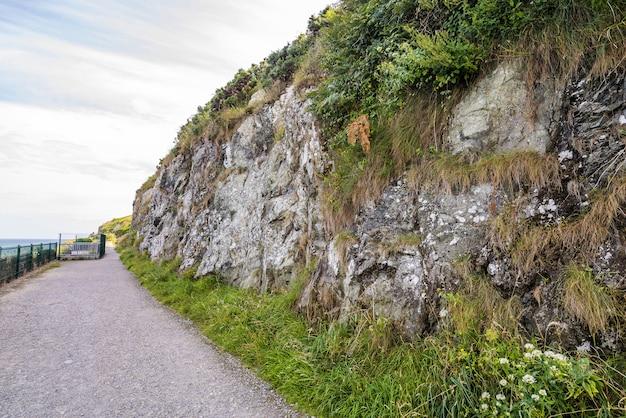Stone rocks mountain hiking path at irish seacoast. bray, greystone