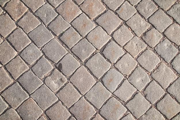 テクスチャ背景の石の正方形のレンガブロックの散歩道