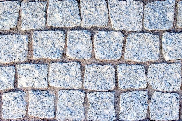 石の正方形のレンガの花崗岩と砂