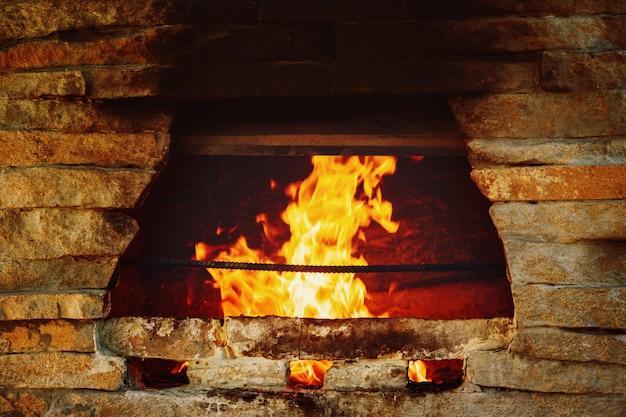 Stone stove burning logs