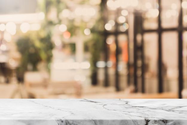 빈티지 필터 돌 테이블 상단 및 흐리게 bokeh 카페와 커피 숍 인테리어 배경-디스플레이에 사용하거나 제품을 몽타주 할 수 있습니다.