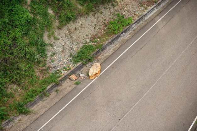 Stone that broke off a rock fell on the road