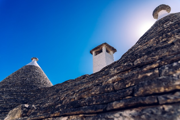 Stone tiles cover the roofs of the trulli in alberobello