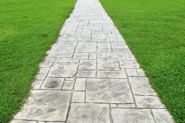 Stone walkway green grass.