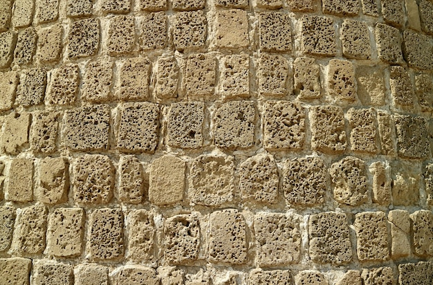 Stone wall of the ancient bahrain fort, unesco world heritage site in manama, bahrain