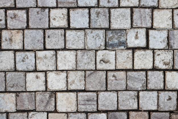 背景またはテクスチャとしての石の壁。外壁のクラッディングとしての組積造の例