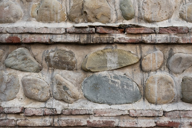 Stone wall. background. vertical and horizontal layers of stone