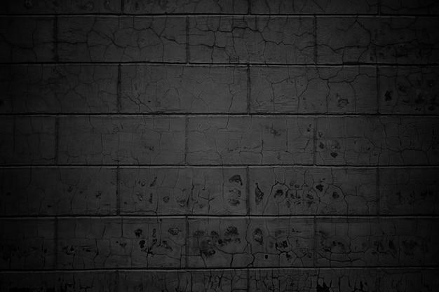 Каменная стена из блоков, черная текстура кирпичей в качестве фона
