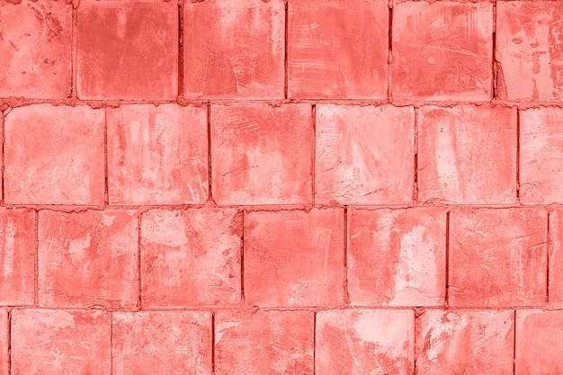 Stone wall of square blocks, coral toned. background texture