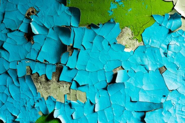 青いひびの入った漆喰の石の壁。デザインの背景。グランジテクスチャ。高品質の写真