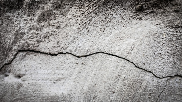 Stone wall with a crack. texture for design