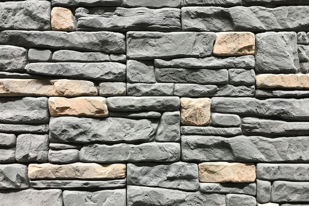 Stone wall with a grey color. concept interior design background and texture