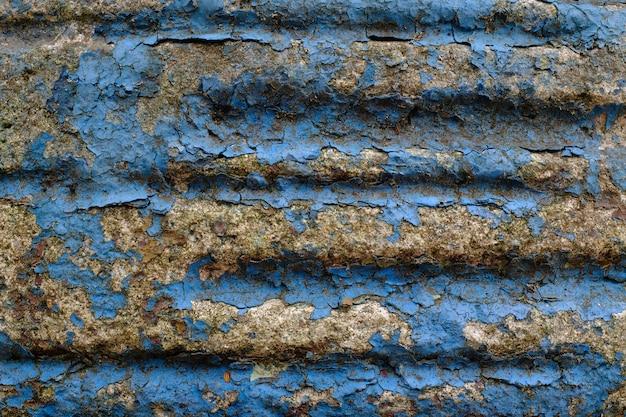 오래 된 파란색 페인트와 돌 벽입니다. 고품질 사진