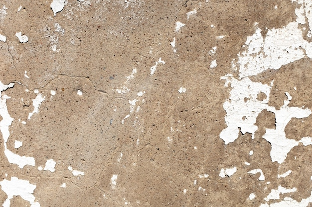 Stone wall with old cracked white paint. high quality photo
