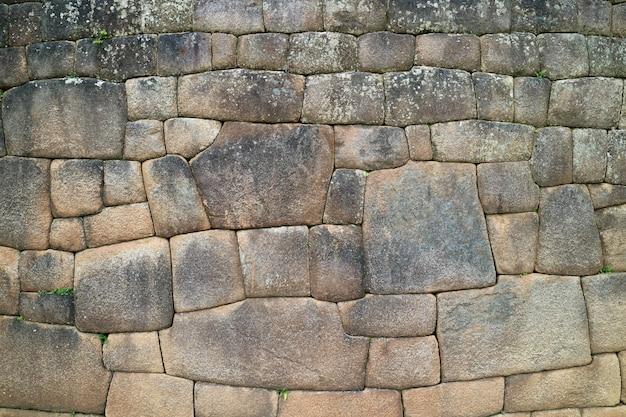Stone wall with unique inca stonework inside machu picchu, cusco, urubamba, peru