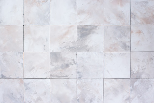 Stone white and beige wall with tiles, background
