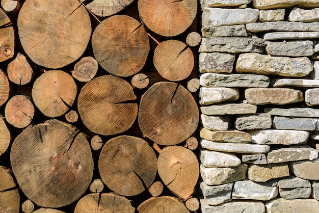 Stone and wood background. building with stone column and wood cross section texture.