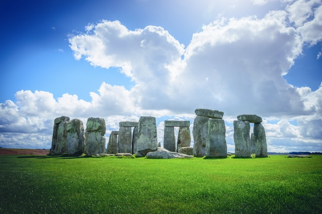 Stonehenge an ancient prehistoric stone monument on blue sky in wiltshire, uk.