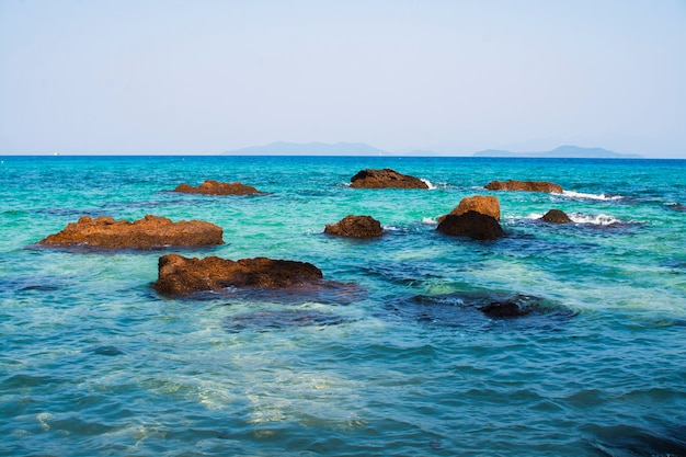 Stones in a blue sea. island in gulf of thailand.