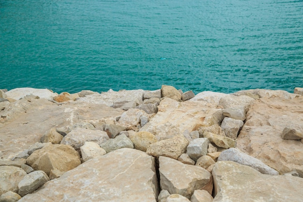 Stones at the blue sea