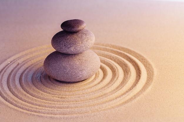 Stones on sand, japanese meditation zen garden close up
