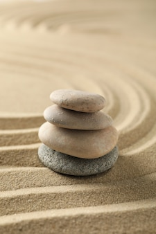 Stones on the sand with patterns. zen concept