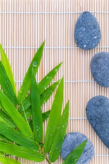 The stones spa treatment scene on bamboo background.