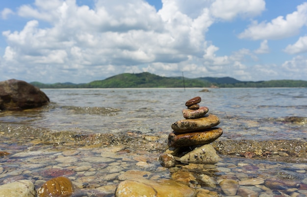 Stones stacked on a beach in the sea
