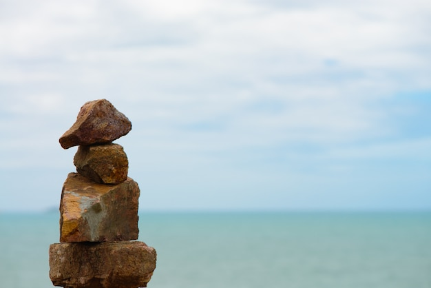 Stones stacked with sea background