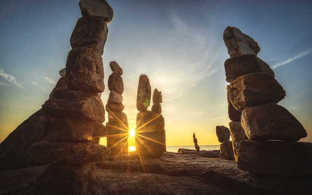 Stones towers on the samed island in thailand with sunrise on the beach.